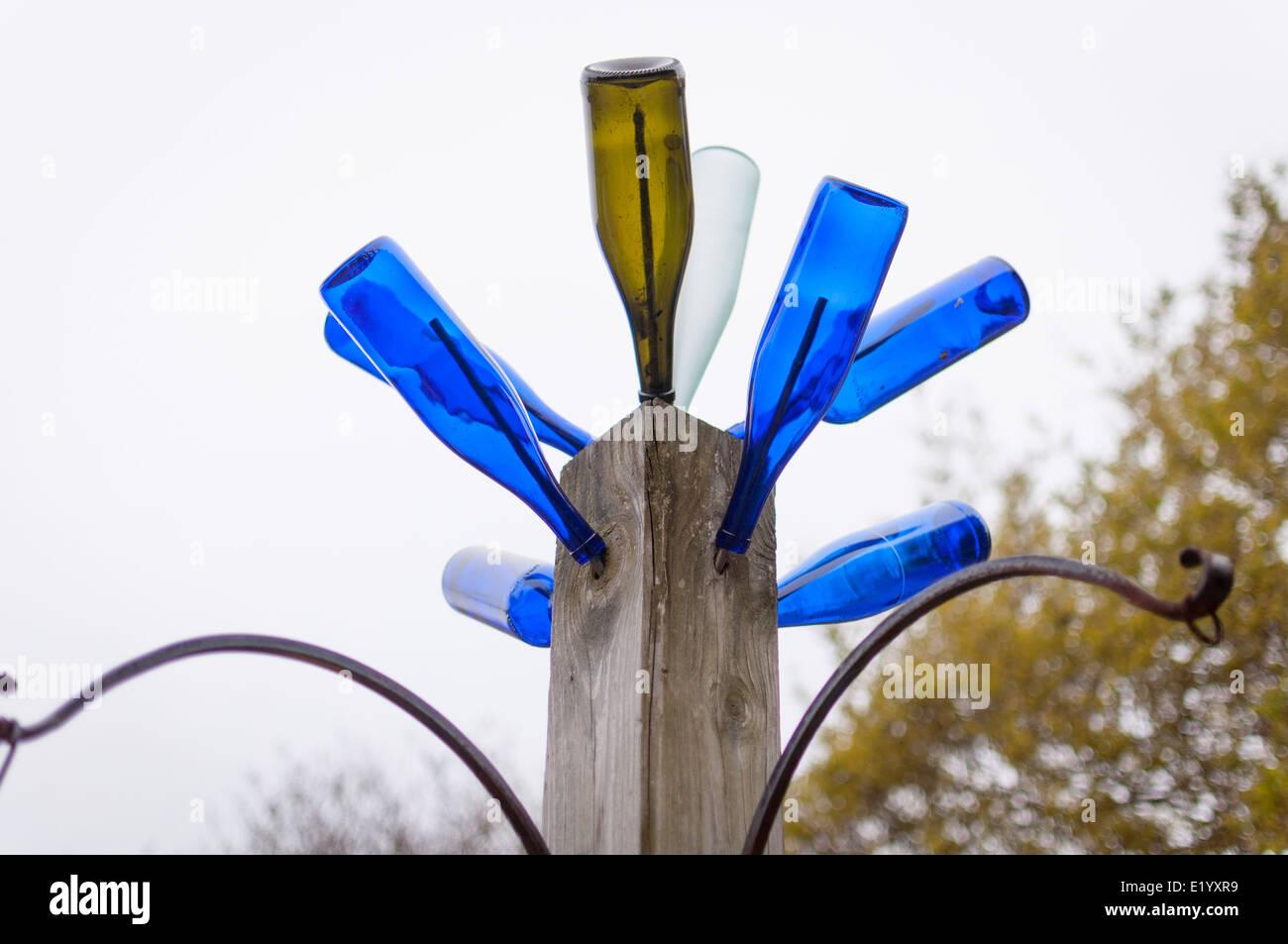 Glass bottle lamp post. - Stock Image