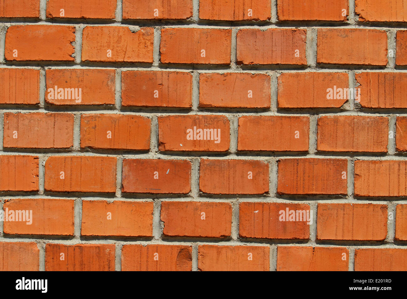 brick red background of a wall of a House with many rectangles - Stock Image