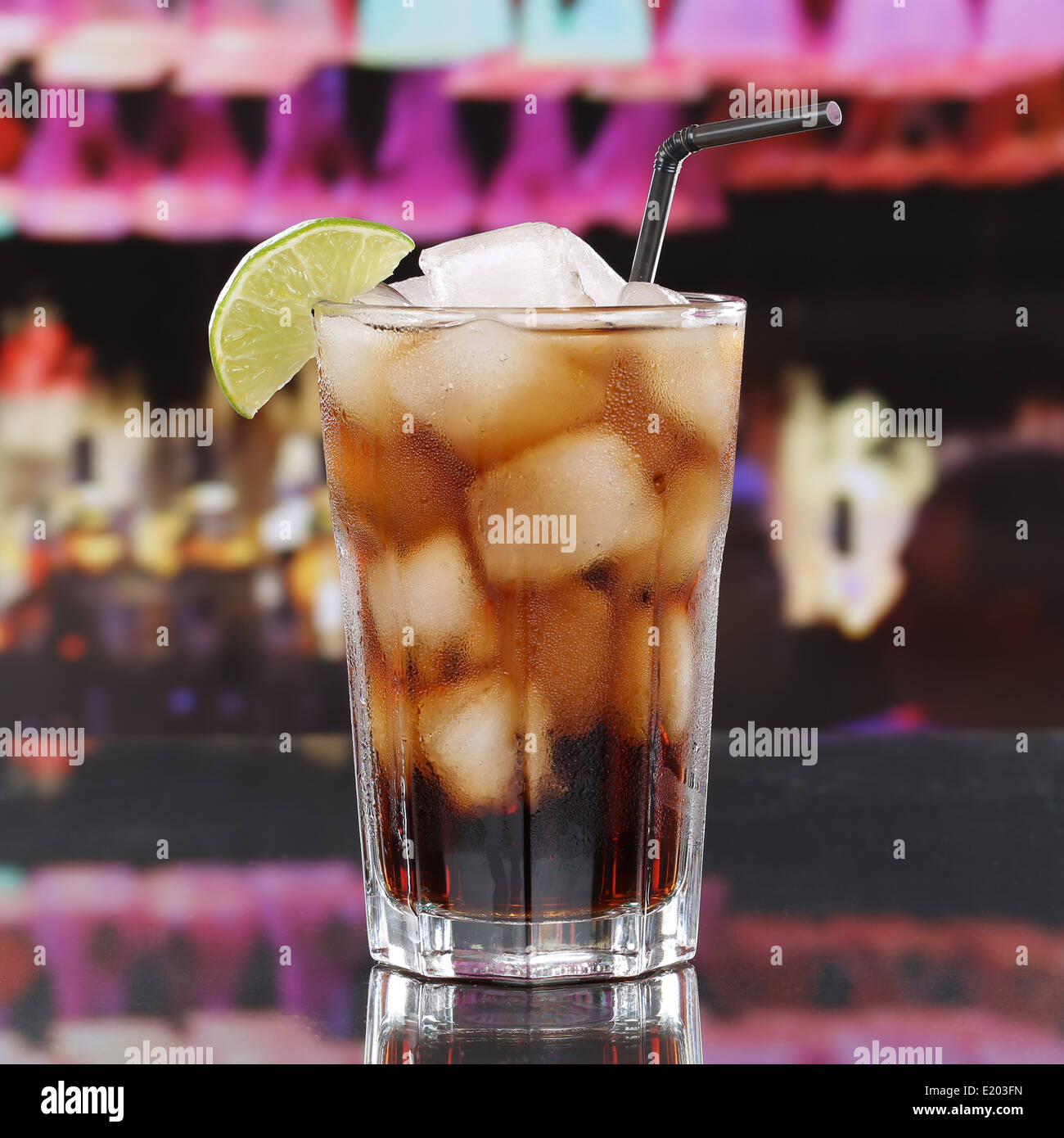 Cold cola drink or Cuba Libre Cocktail with ice cubes in a bar or a party - Stock Image