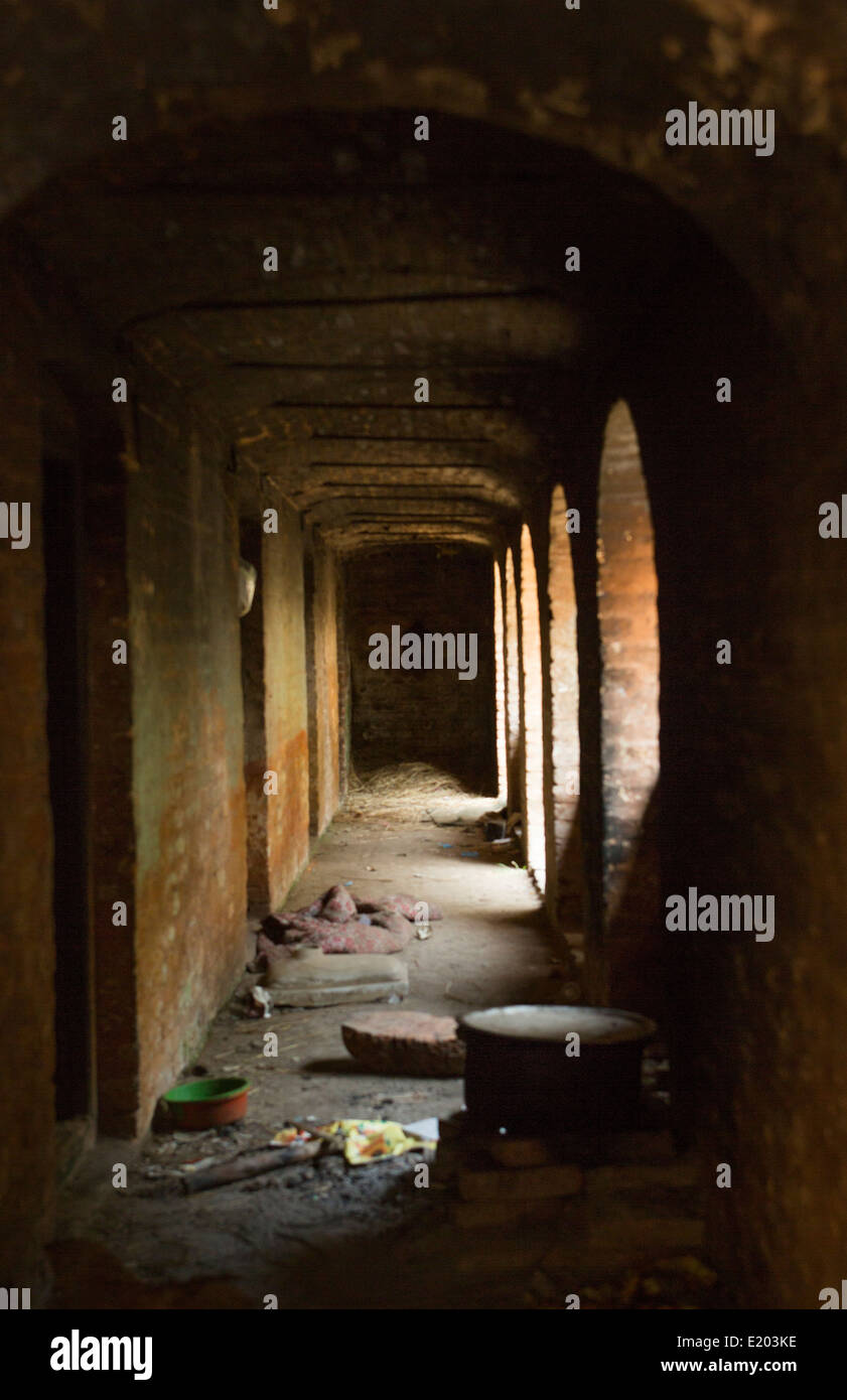 Kathmandu Nepal Dark walkway to the pilgrim dormitories where they stay when they arrive at Pashupatinath, - Stock Image