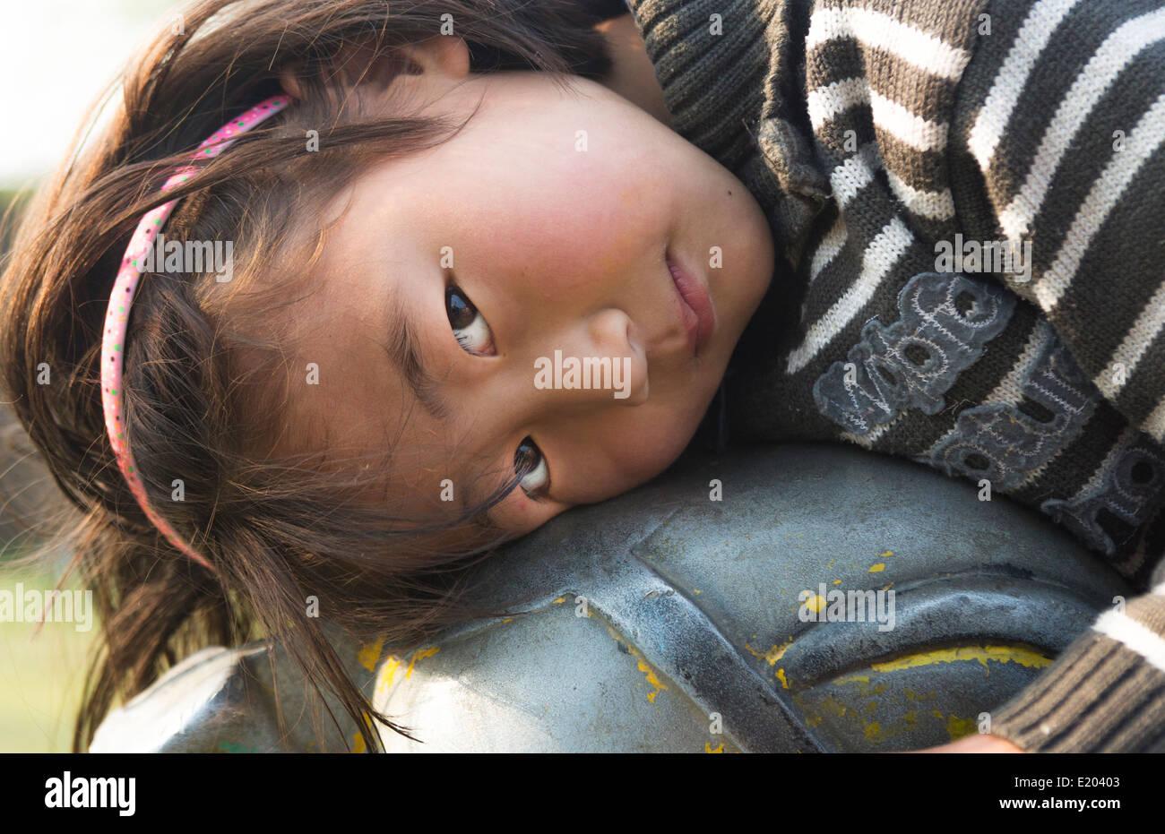 Kathmandu Nepal Nepali child posing for camera. Nayapati Eastern Kathmandu 1 - Stock Image