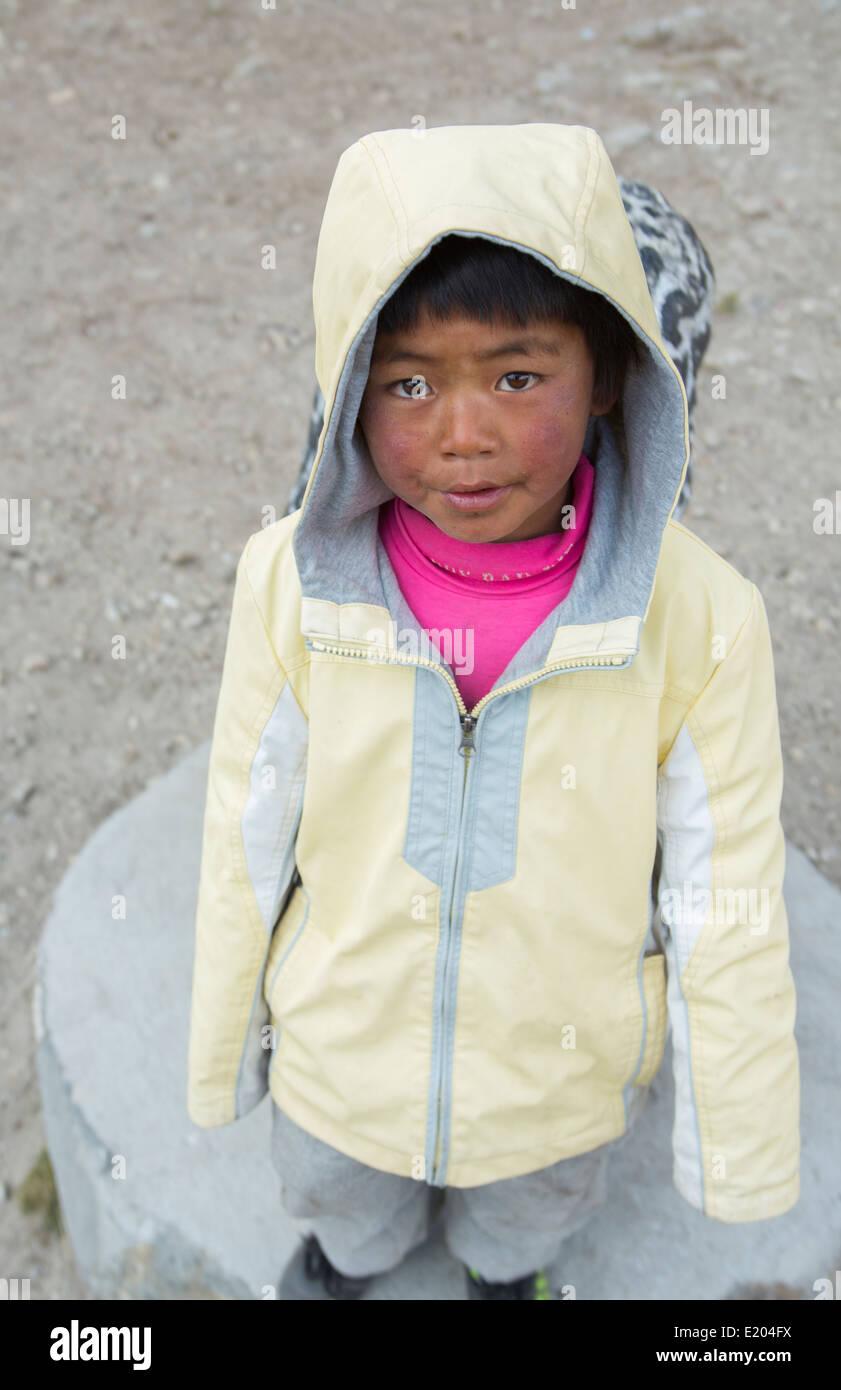 Nepal Child boy age 7 portrait in Khumjung, Solukhumbu., remote, Mt Everest, Himalayas 77 - Stock Image