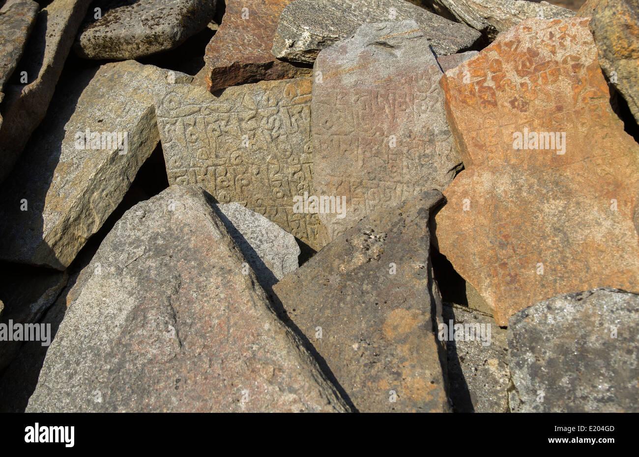 Nepal Mani stones on a Mani Wall in Khumjung Solukhumbu, remote, Mt Everest, Himalayas - Stock Image
