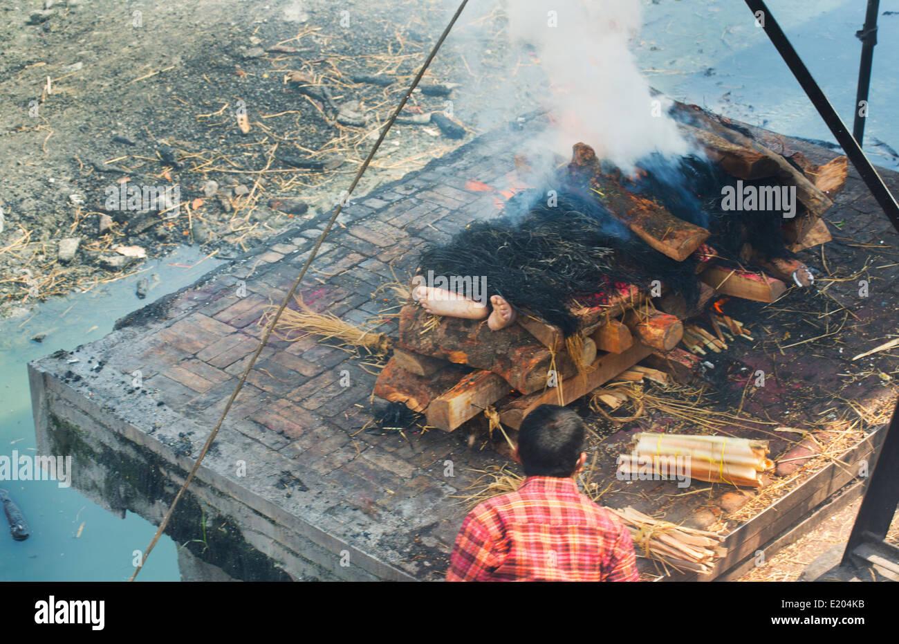 Kathmandu Nepal. a public cremation Pashupatinath, Buddhist, Buddhism death, dead, burn, cremate - Stock Image