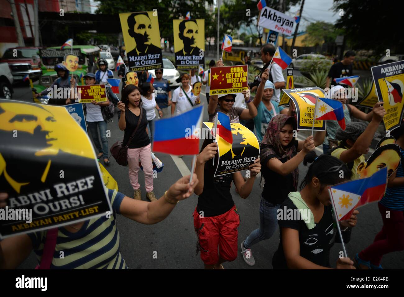 Makati, Philippines. 12th June, 2014. Demonstrators hold a protest a protest outside the Chinese consulate in Makati, - Stock Image