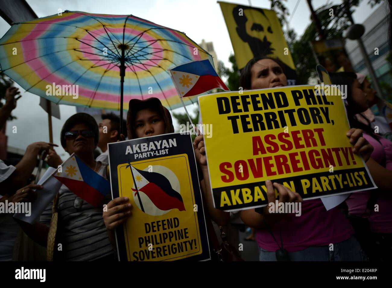 Makati, Philippines. 12th June, 2014. Demonstrators hold a protest outside the Chinese consulate in Makati, Metro - Stock Image
