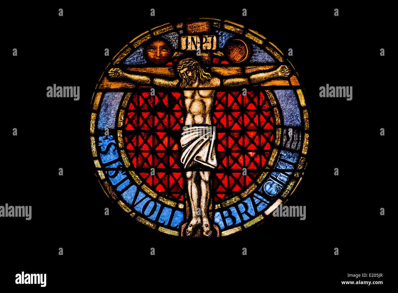 round stained glass window at the lutheran church of sessenheim showing jesus at the cross Stock Photo