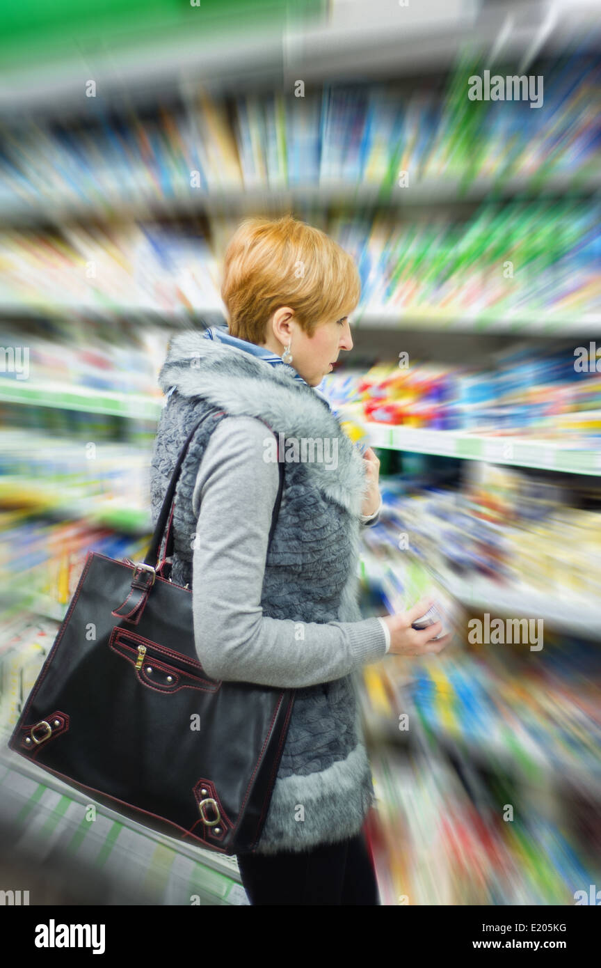 woman doing shopping in a supermarket Stock Photo