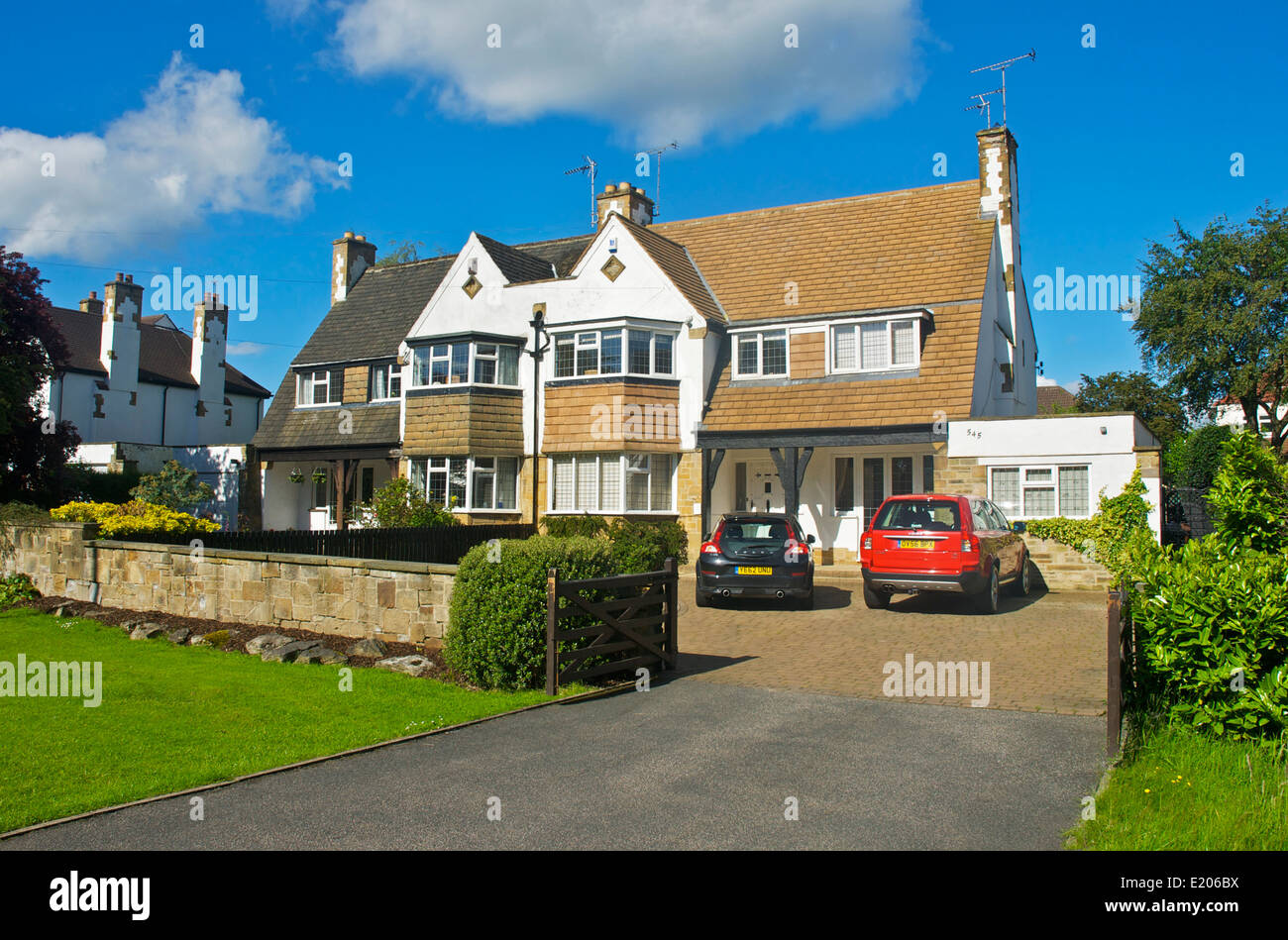 Typical suburban semi-detached houses, in Adel, near Leeds, West Yorkshire, England UK - Stock Image