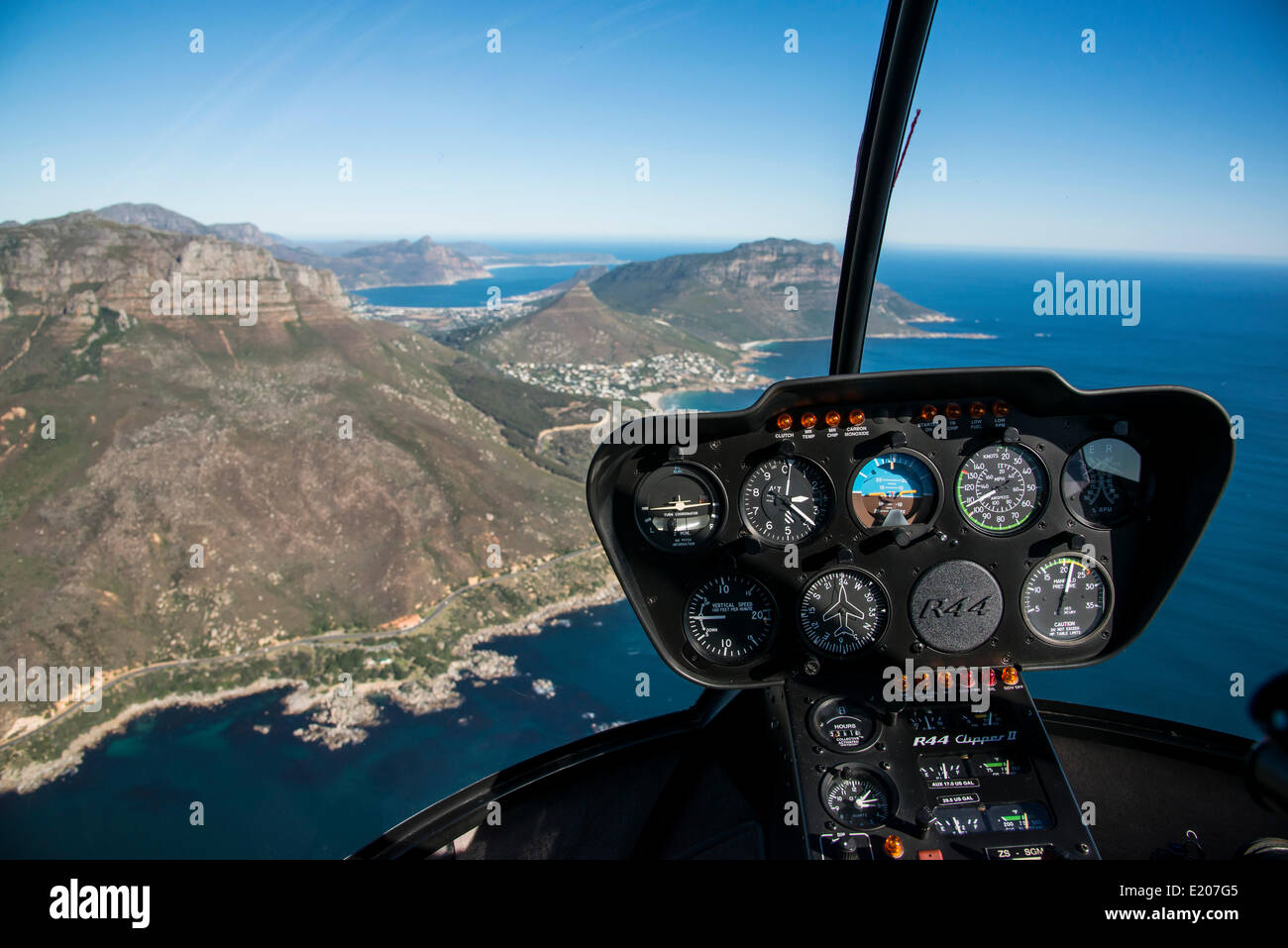 Aerial view, Clipper R44 helicopter dashboard controls over Cape Town, Western Cape, South Africa - Stock Image