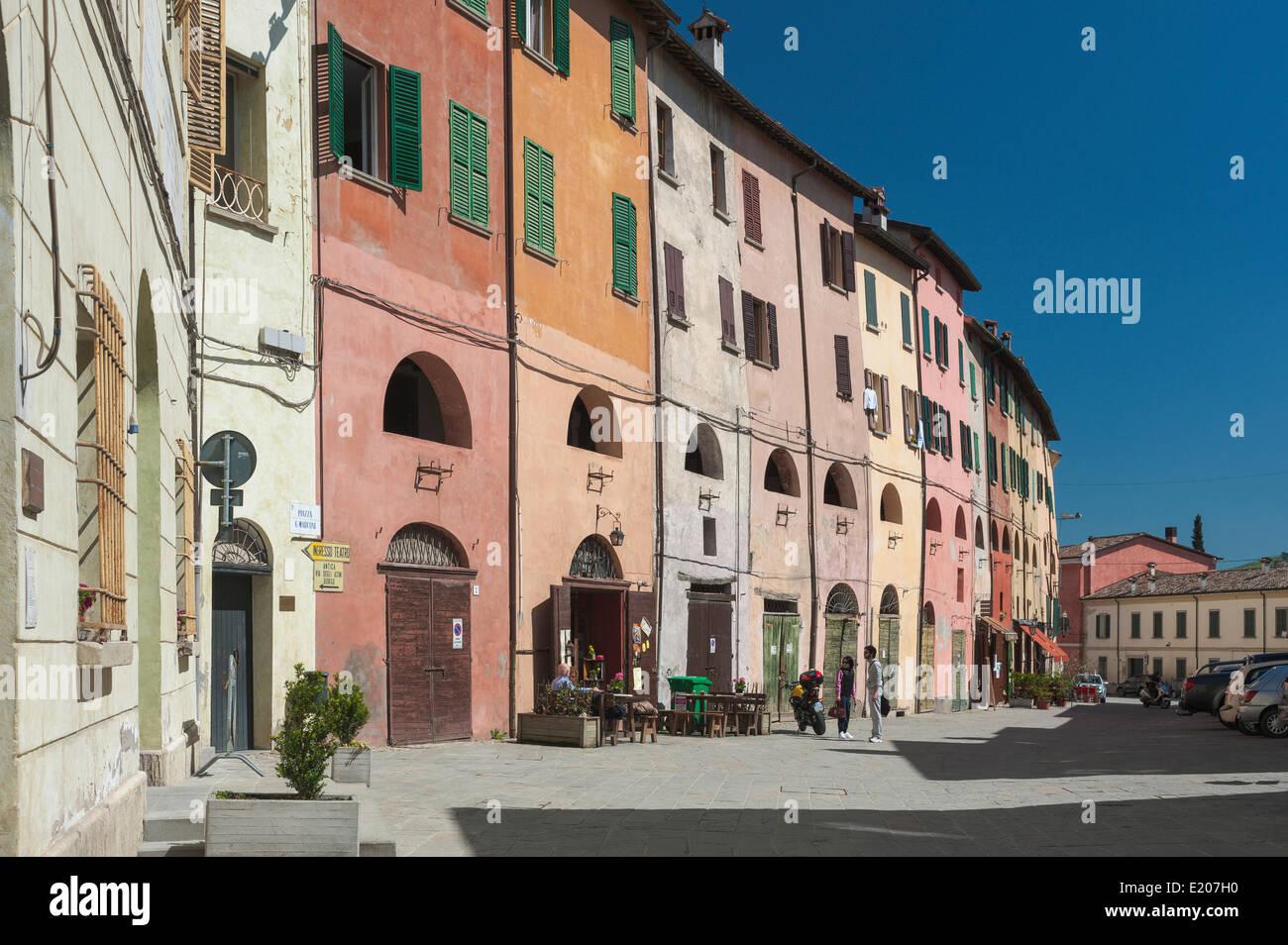 Historic row of houses with portico on the first floor, 15th century, Piazza Guglielmo Marconi, Brisighella, Emilia - Stock Image