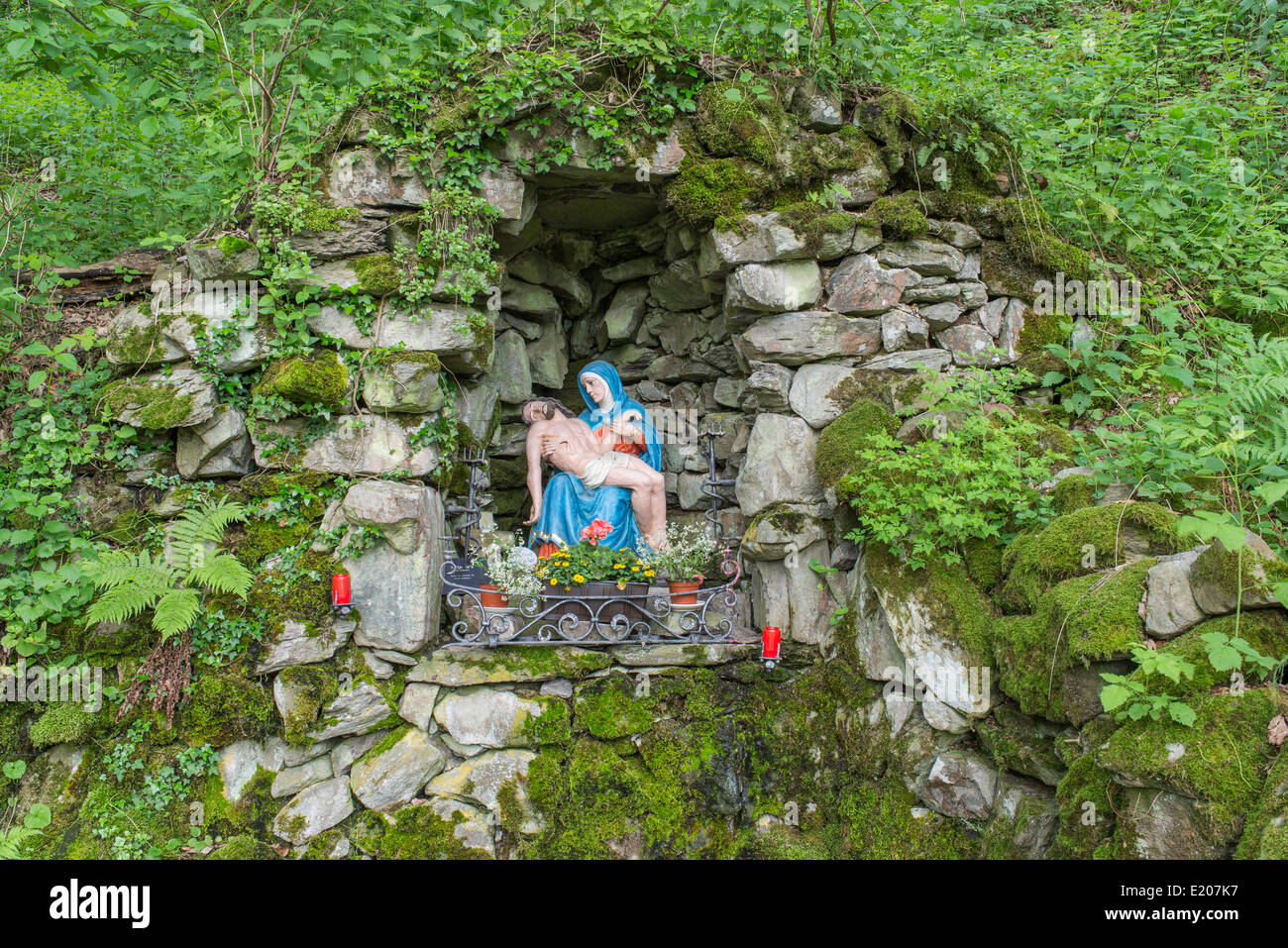 Wayside shrine between basalt blocks, ascent to the Milseburg, Danzwiesen, Hofbieber, Hesse, Germany - Stock Image