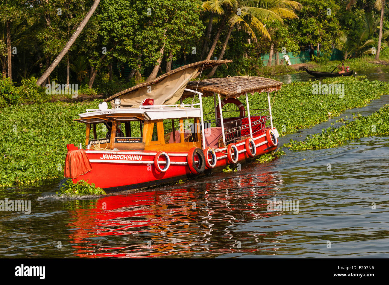 Red boat, Backwaters, Alleppey, Alappuzha District, Kerala, India - Stock Image
