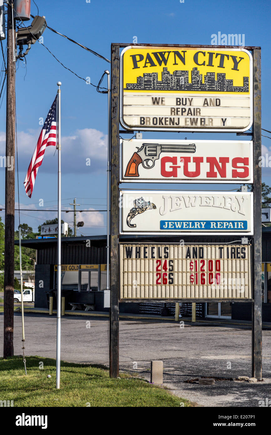Advertising signs, gun shop and pawn shop with American flag, Georgia, United States - Stock Image