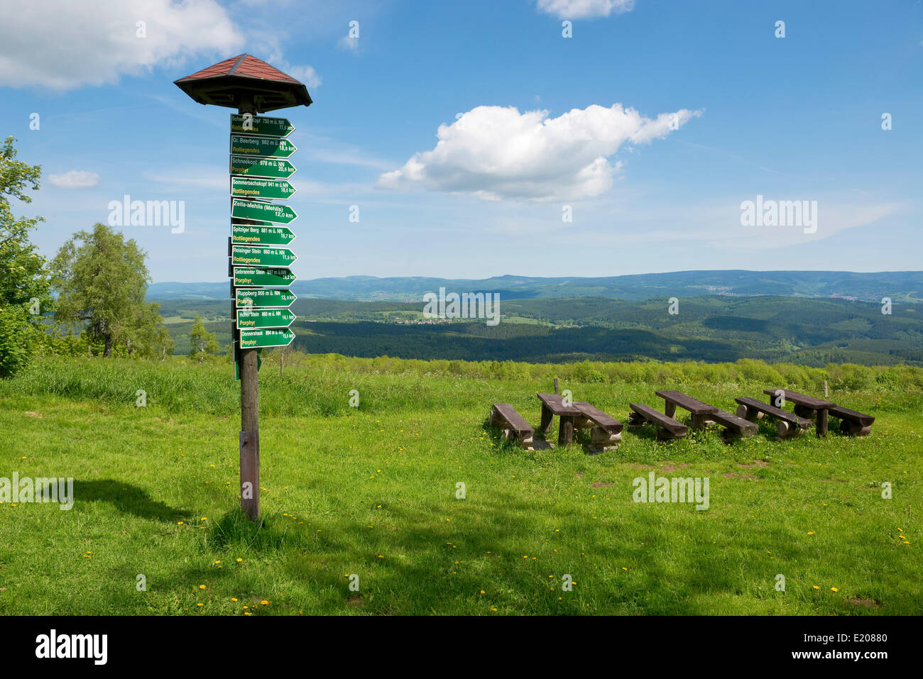 Signsposts, distance markers, wooden benches and tables on Mt Dolmar with views of the Thuringian Forest, Thuringia, - Stock Image
