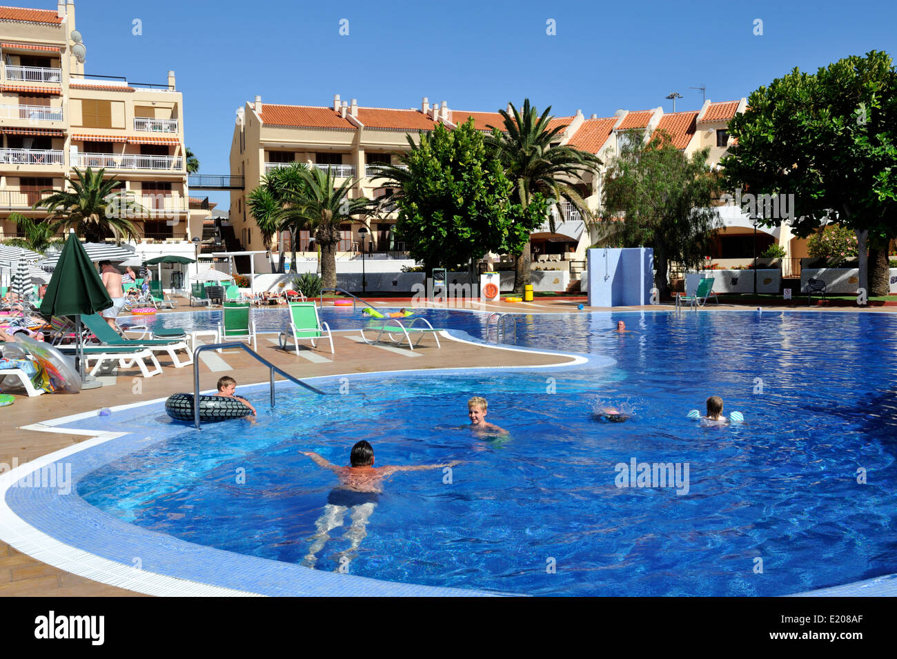 Holiday Apartment Pool And Building In Playa De Las Americas Stock