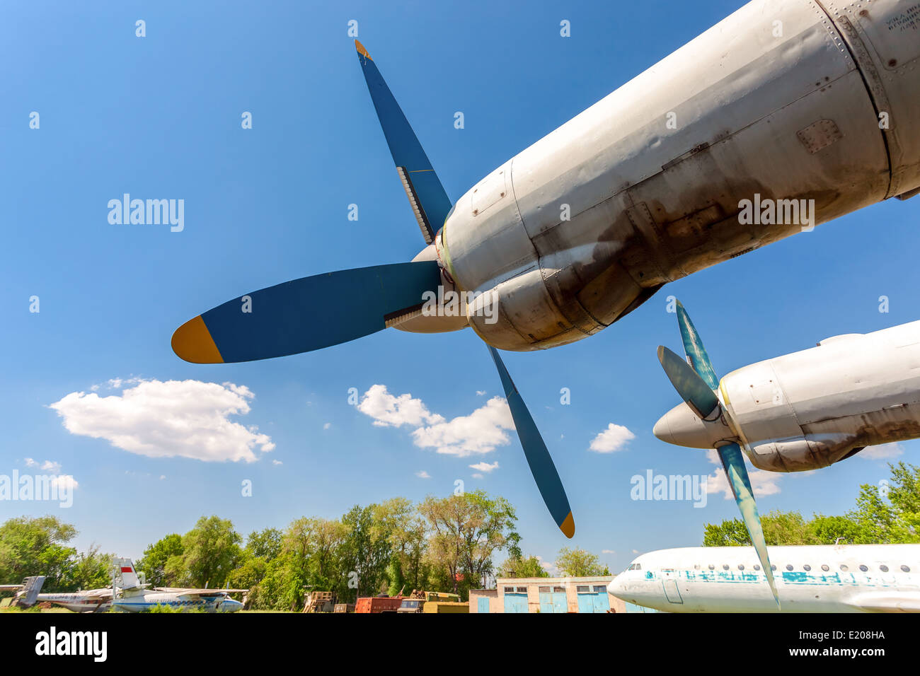 Turbines of turboprop aircraft An-12 at an abandoned aerodrome - Stock Image