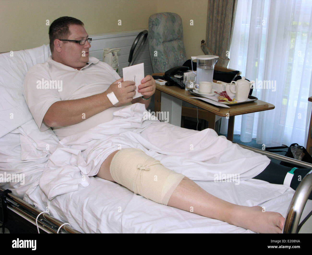 Man In Hospital With A Bandaged Knee U0026 Leg After A Knee ...