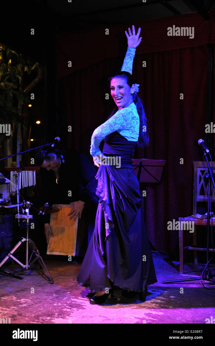 Flamenco dancer on stage with drummer in background, Tenerife Restaurant Embrujo - Stock Image