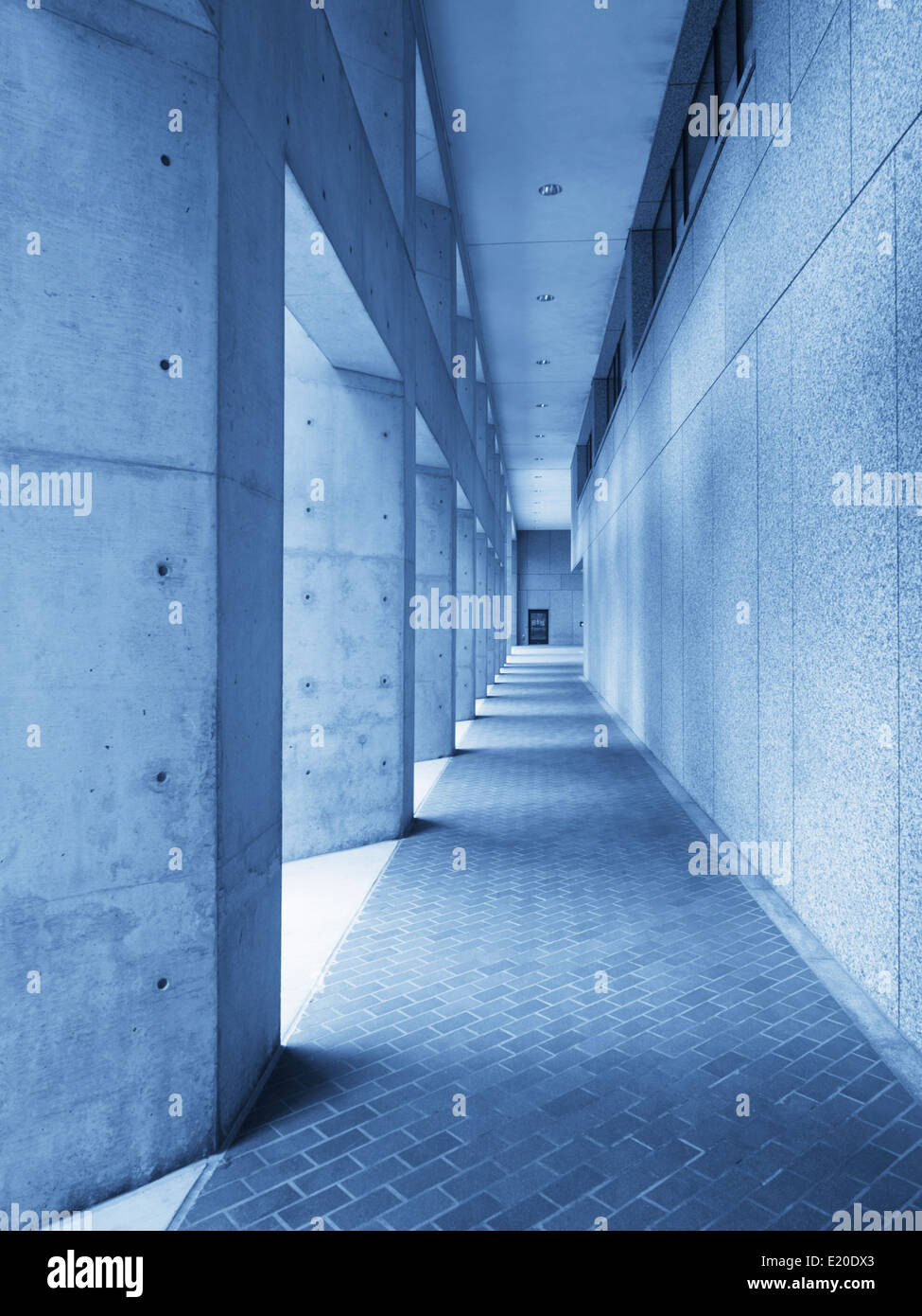 Concrete hallway in blue perspective - Stock Image