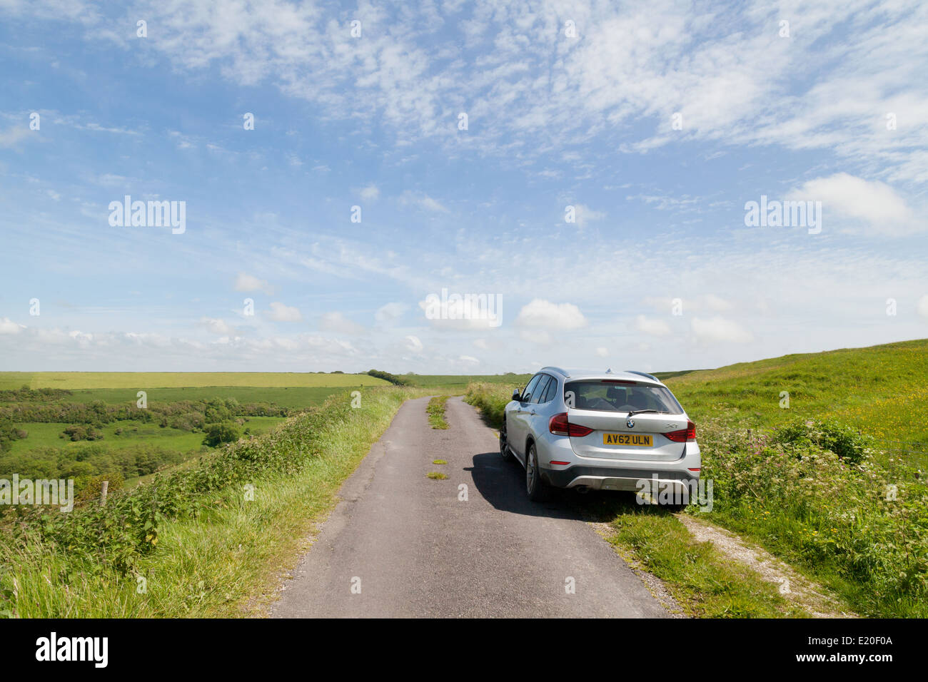 Car parked on a country road in summer, Dorset England, UK - Stock Image