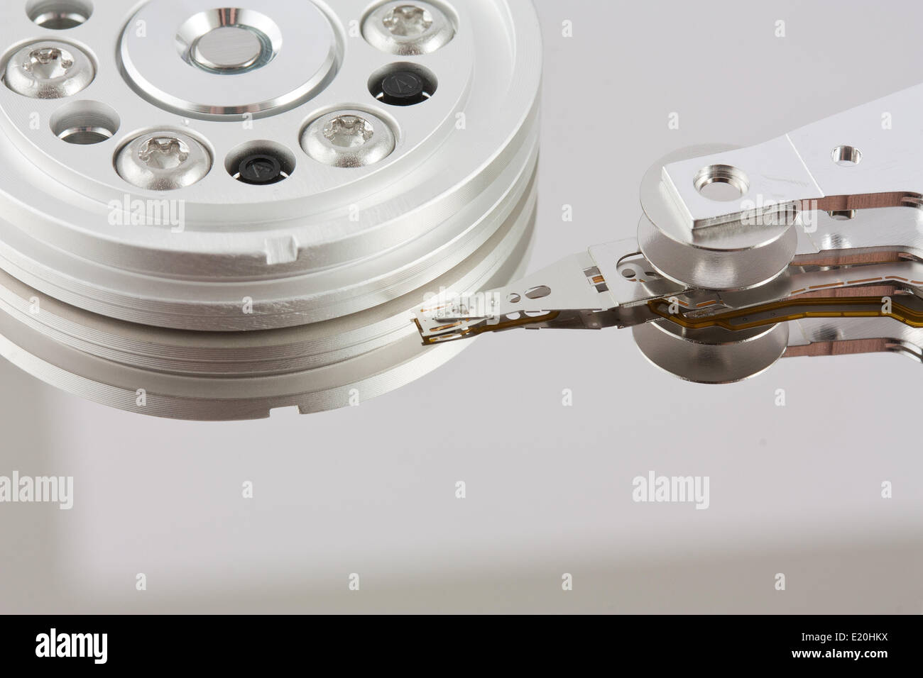 Platters and head of a computer hard drive - Stock Image