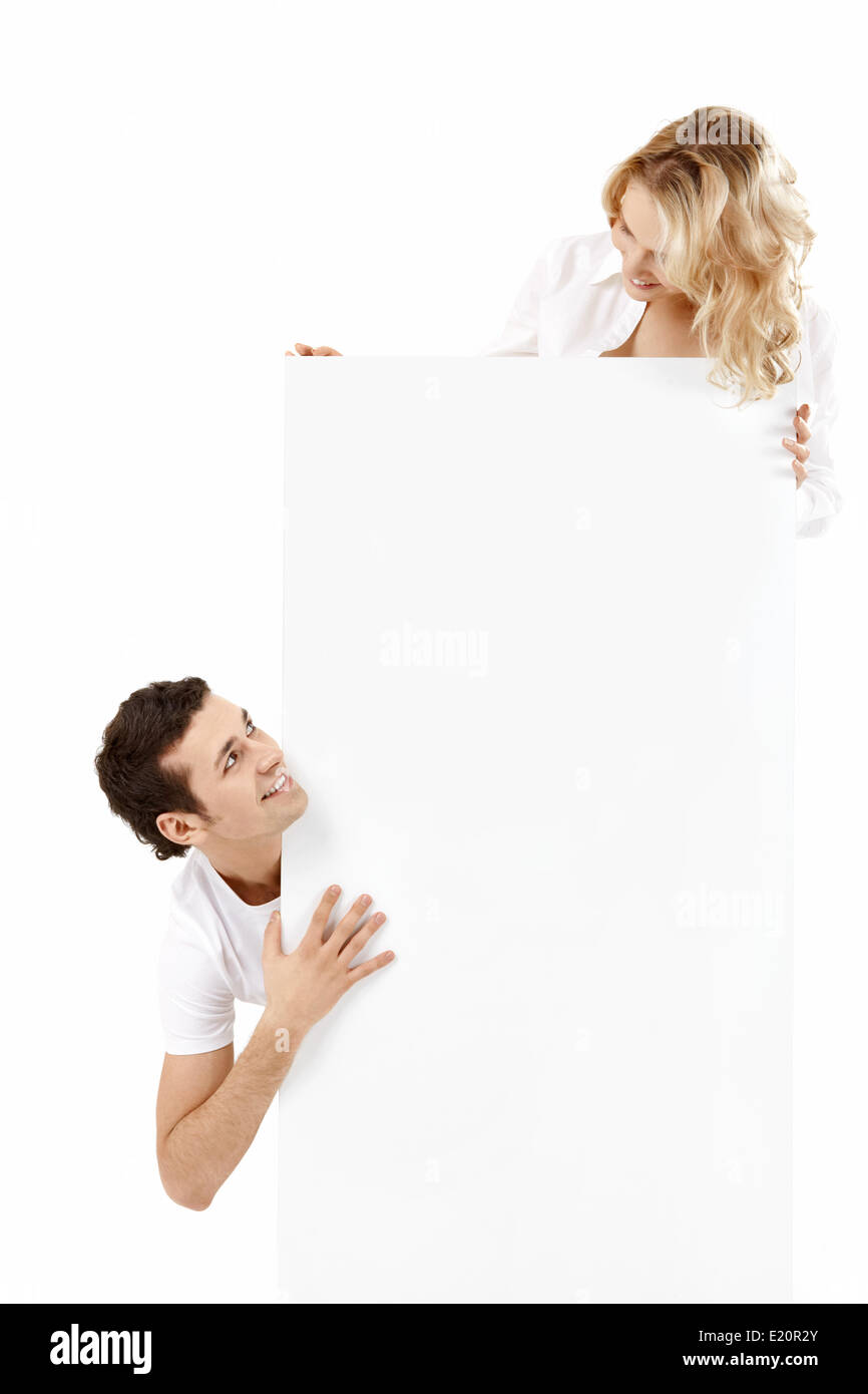 Two young people hold an empty banner Stock Photo