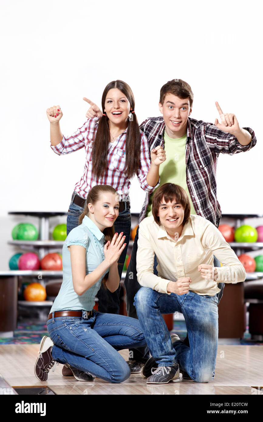 Young people expect a victory in bowling - Stock Image