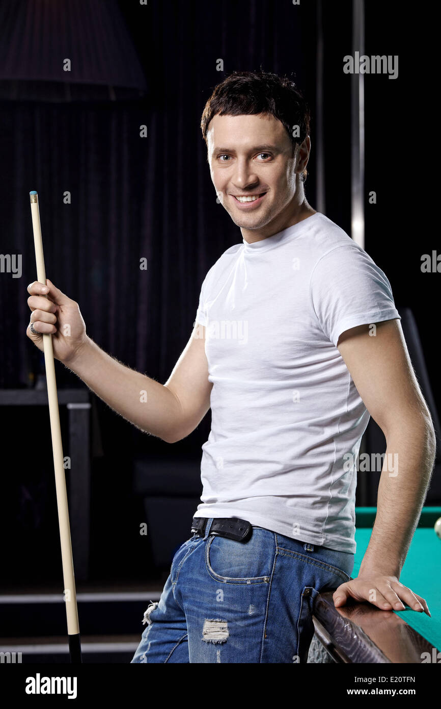 The young nice man with cue close up - Stock Image
