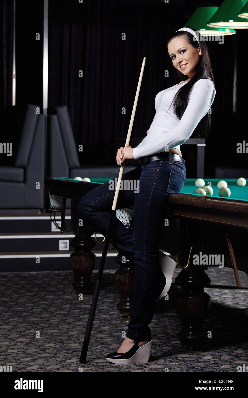 The young nice girl with cue - Stock Image