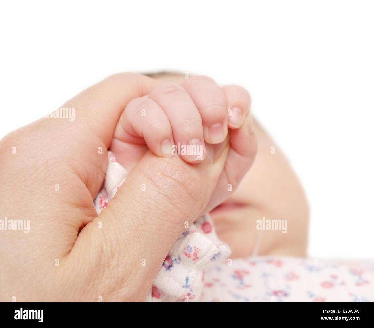 Baby holding onto a grownups hand - Stock Image