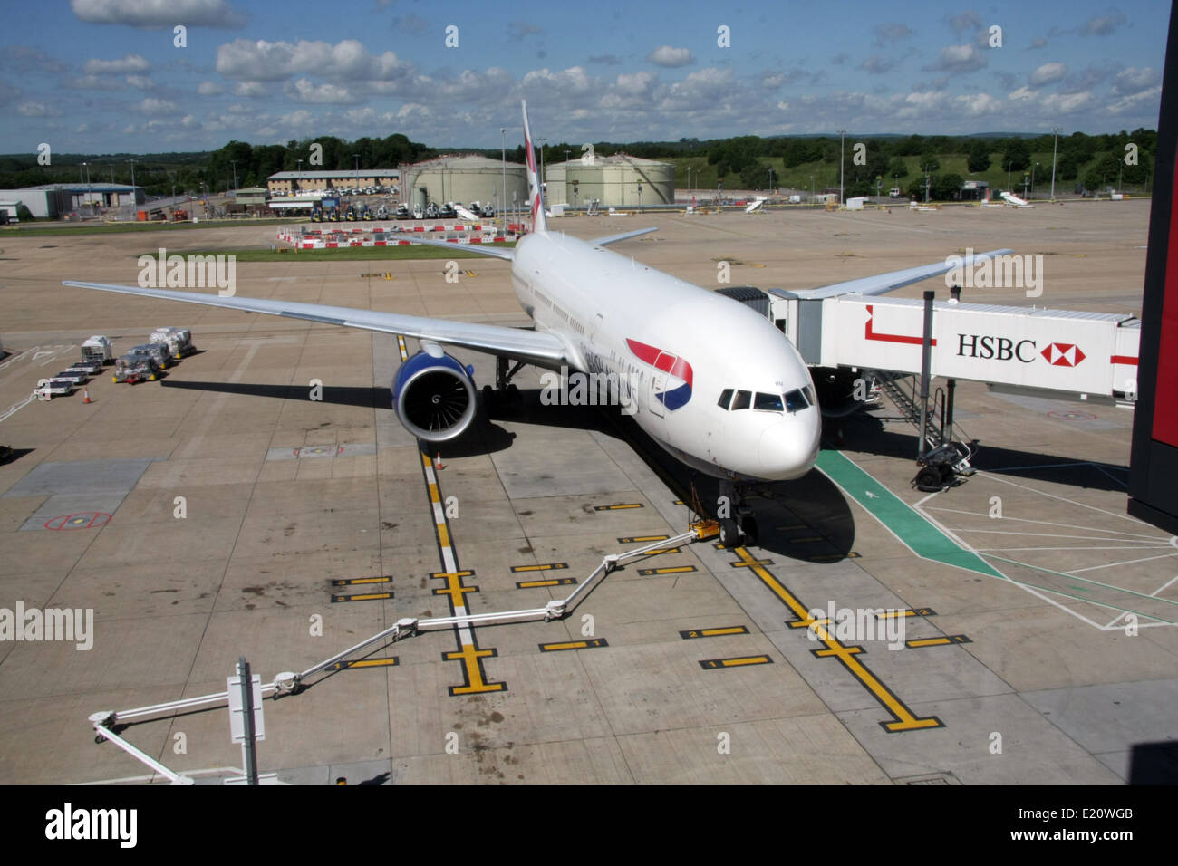 a British Airways Boeing 777 on its stand at London Gatwick Airport - Stock Image