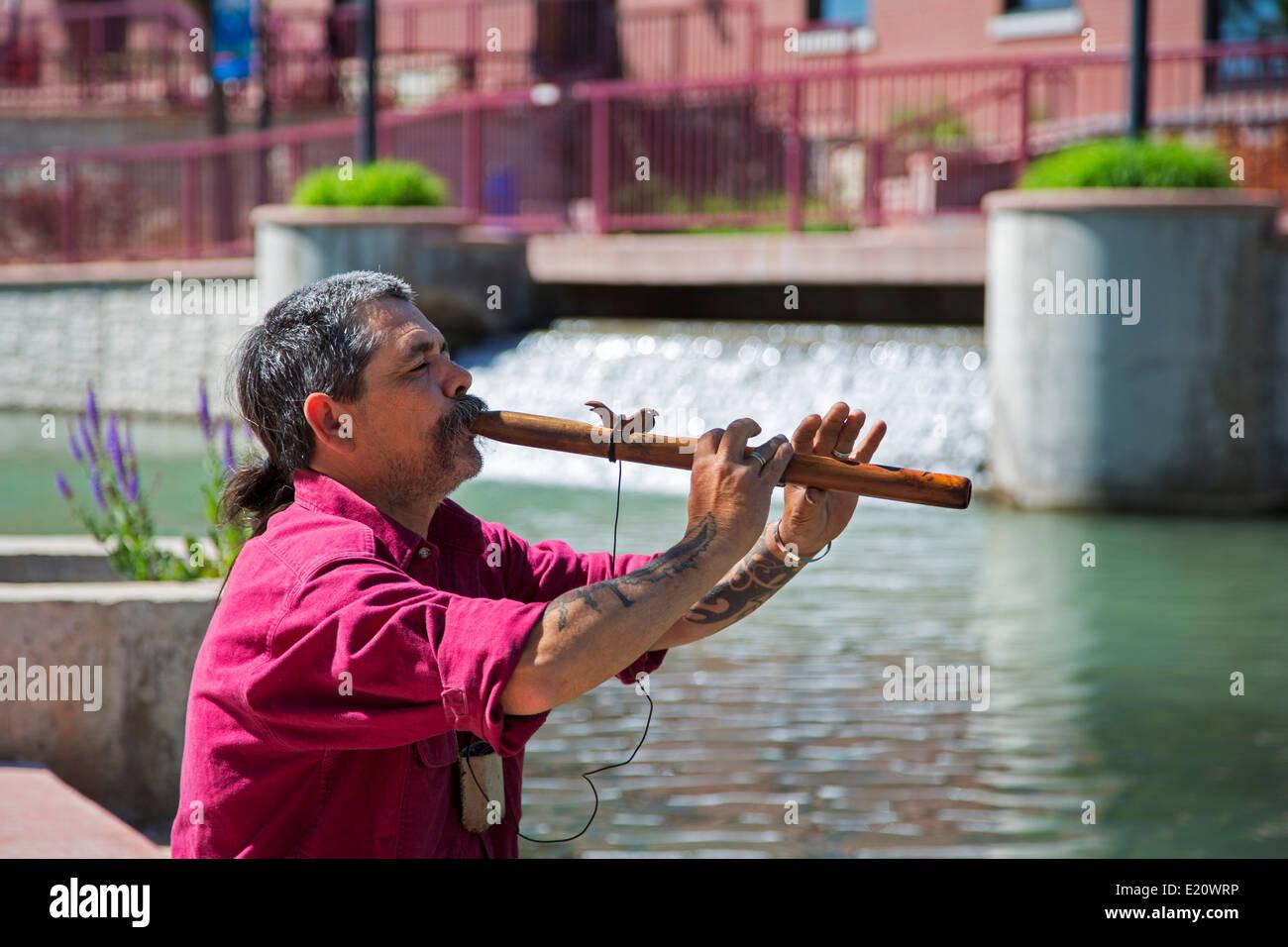 Pueblo, Colorado - A musician plays his flute on the Historic Arkansas Riverwalk of Pueblo. - Stock Image