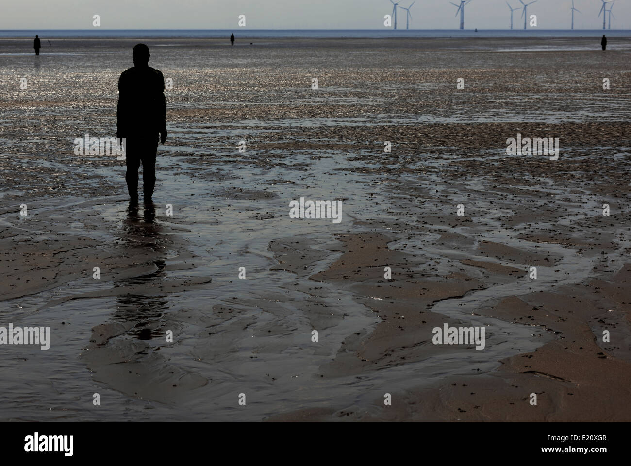 Another Place, artistic installation,Anthony Gormley statues on Crosby beach - Stock Image