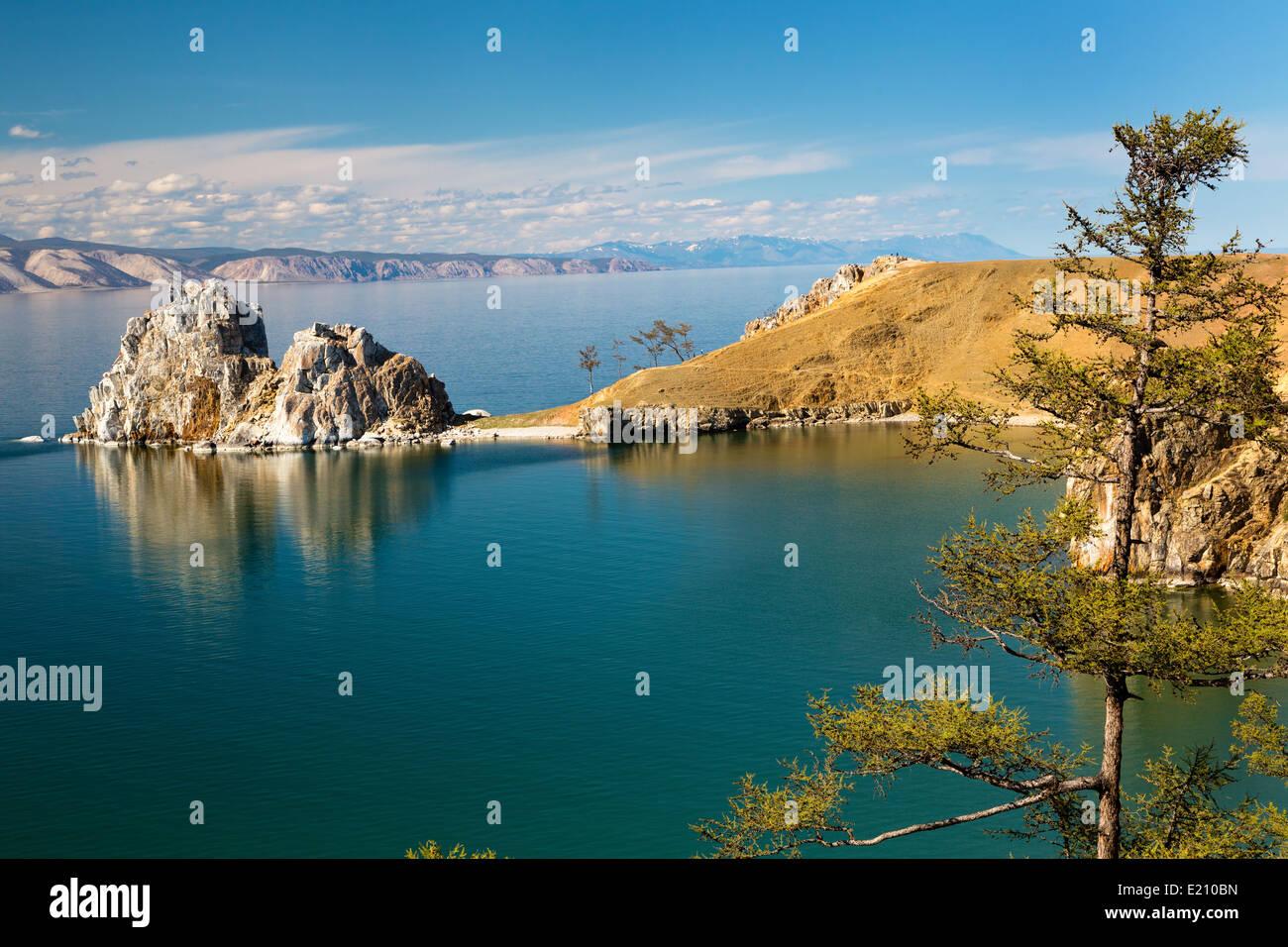 View of coast of Baikal lake, Shaman rock and cape Burhan on Olkhon Island, Russia - Stock Image