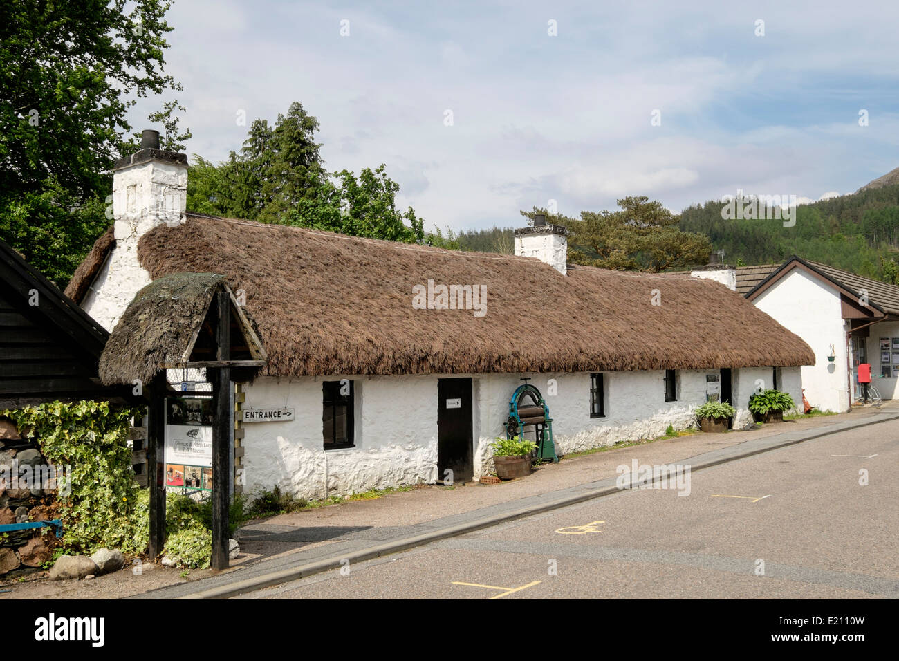 Glencoe and North Lorn Folk Museum in old thatched traditional building in village street in Scottish Highlands. - Stock Image