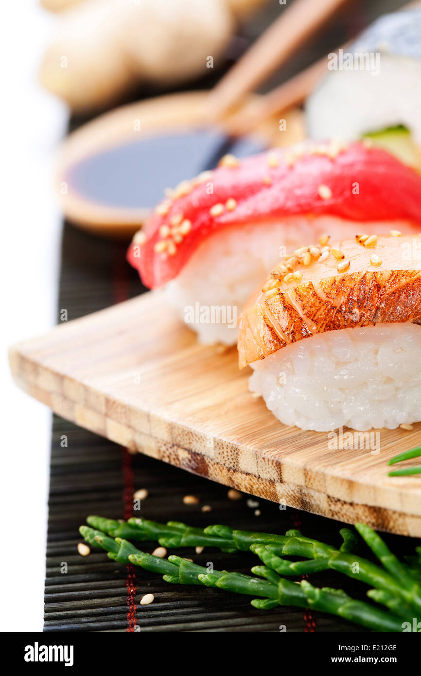 set of japanese sushi with chopsticks and soy sause over white rice Stock Photo