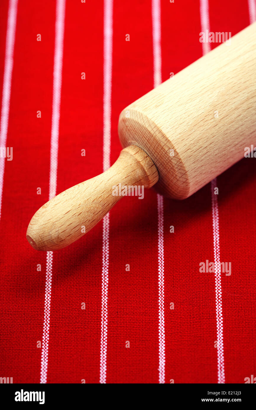 rolling pin on a table - Stock Image