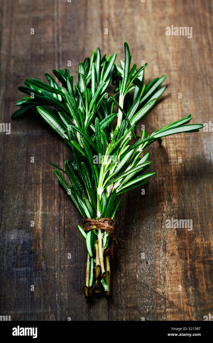 Rosemary bound on a wooden board - Stock Image
