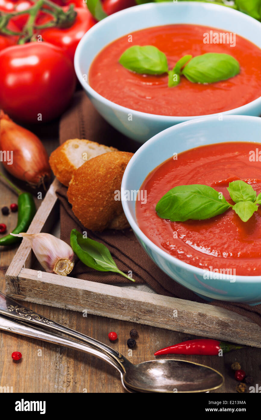Traditional tomato soup and ingredients - Stock Image