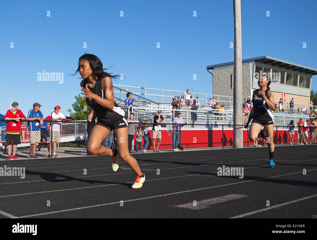 High school athletes compete in a track and field meet in Milwaukee, Wisconsin, USA. - Stock Image