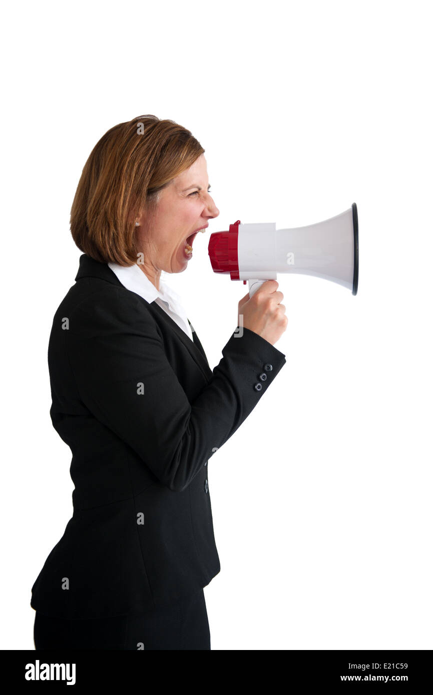angry businesswoman shouting into a loudhailer or megaphone isolated on a white background - Stock Image