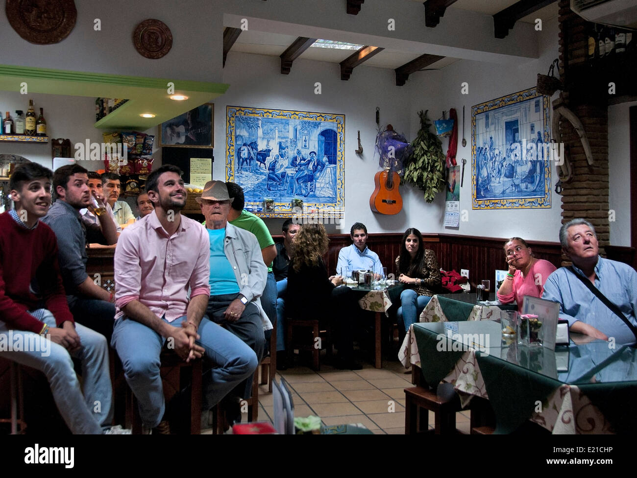 People watching football soccer on Television (  FIFA World Cup Brazil ) Bar Pub Cafe  Arcos de Frontera Spain Spanish - Stock Image