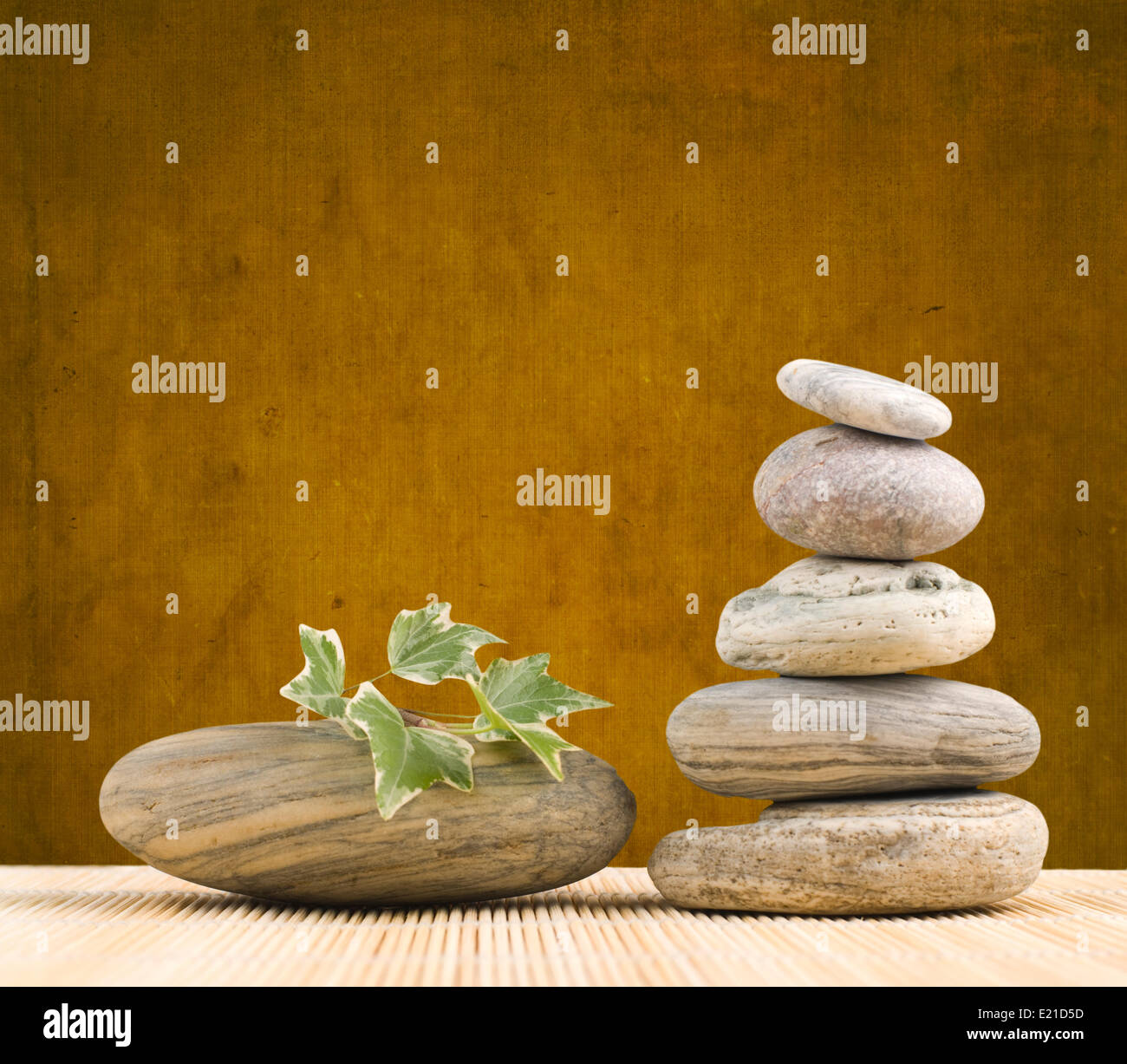Stack pebbles with grungy background - Stock Image
