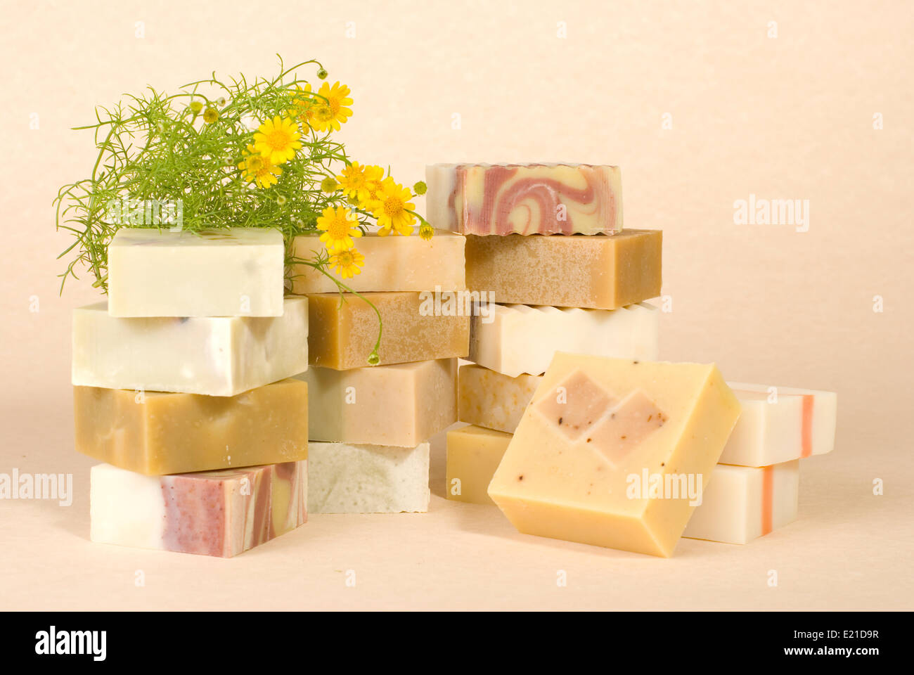 group of handmade soap with herbal material - Stock Image