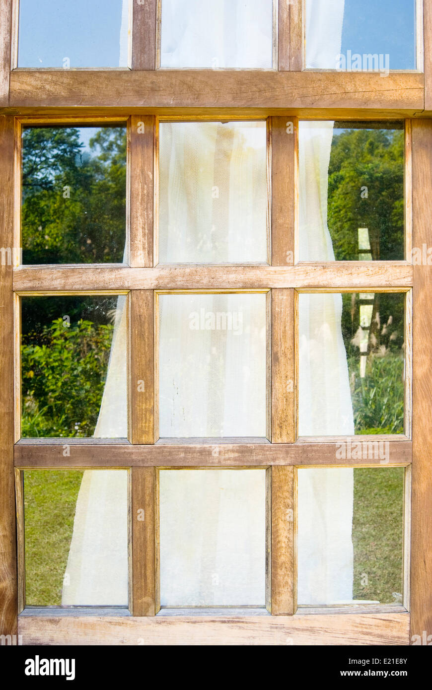 Old wooden windows with drape - Stock Image