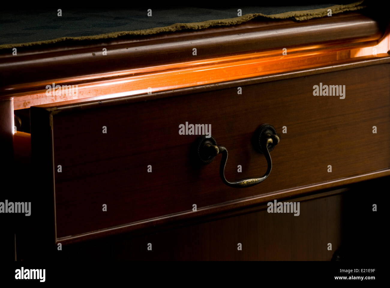 Mystery light from the wooden drawer - Stock Image