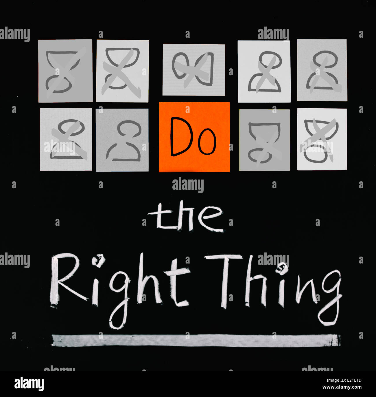 Do the right thing, words on blackboard. - Stock Image