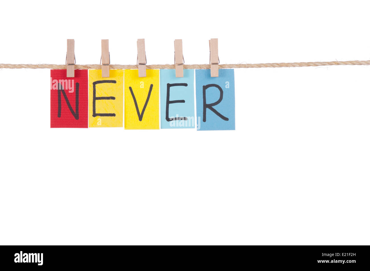 Never, Wooden peg  and colorful words - Stock Image