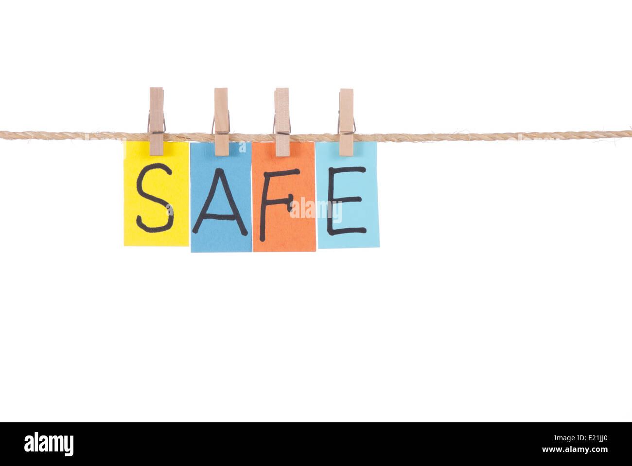 Safe, Wooden peg  and colorful words - Stock Image